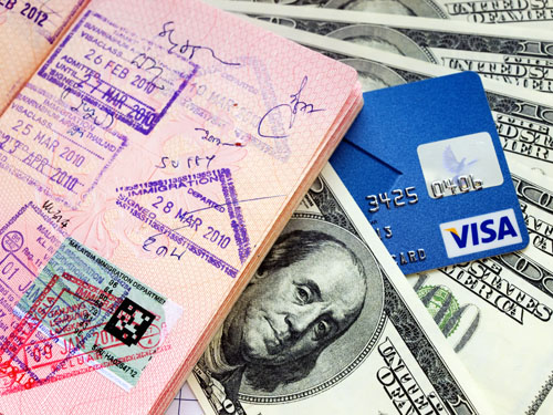 Passport with visas, credit card, money and credit card. Travel concept.,